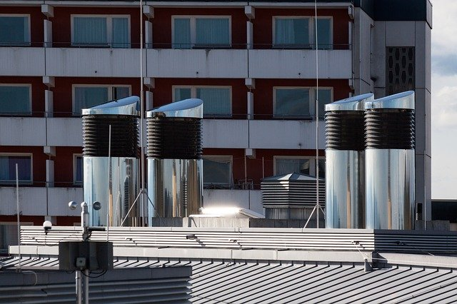 Picture of an industrial air conditioner vent on a buildings roof.